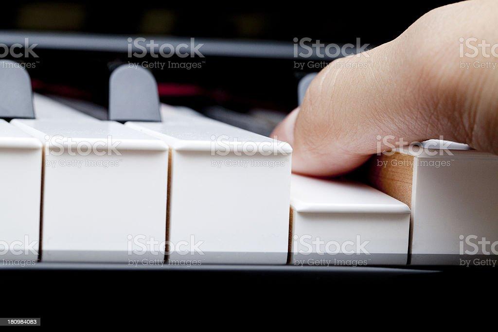 Finger on piano royalty-free stock photo