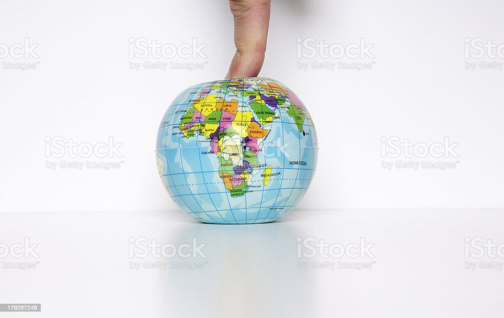 Finger on the planet royalty-free stock photo