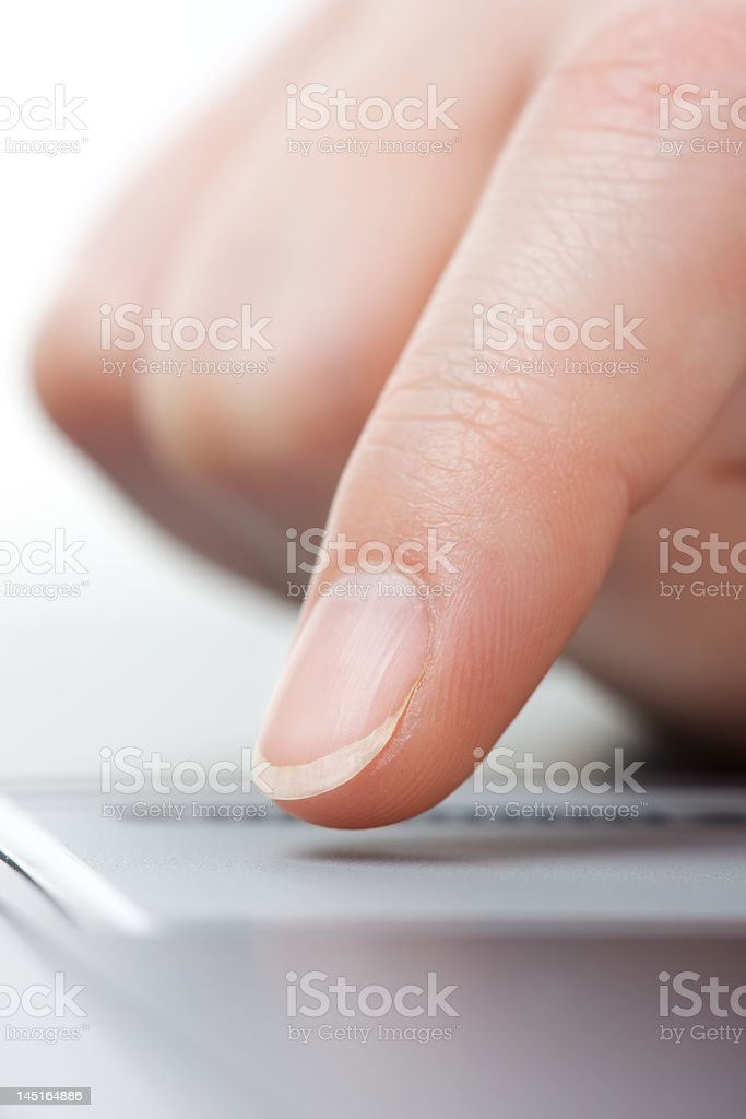 Finger on the touchpad royalty-free stock photo