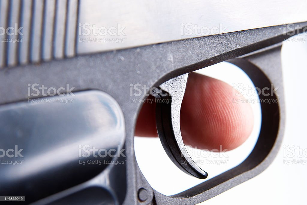 Finger on the trigger of a gun royalty-free stock photo