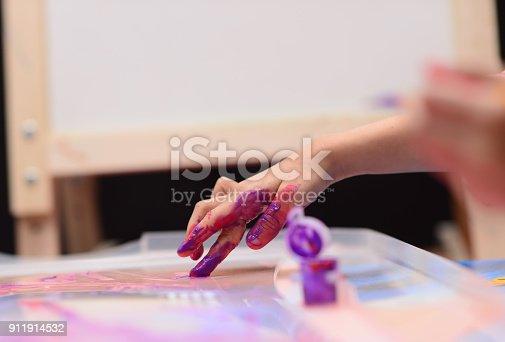 154371635istockphoto Finger painting 911914532