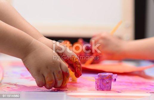 154371635istockphoto Finger painting 911914580