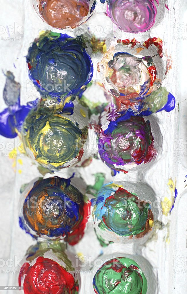 Finger paints in an egg crate for art royalty-free stock photo