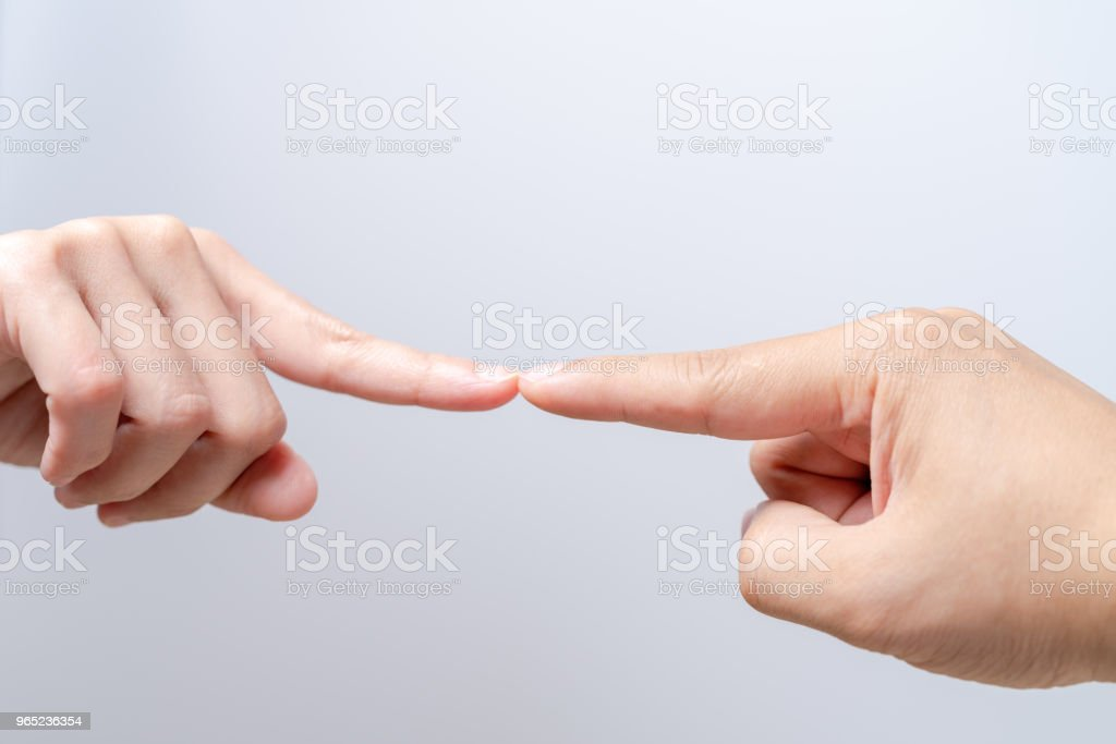 finger point touching men and women hands reaching towards each other. Diversity differential concept royalty-free stock photo