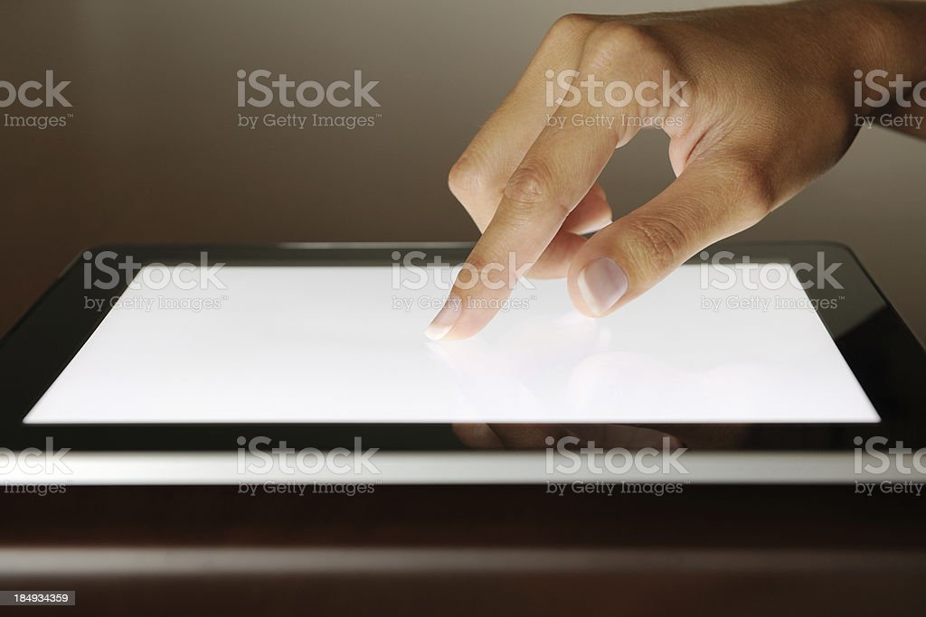 Finger pointing on a Digital Tablet royalty-free stock photo