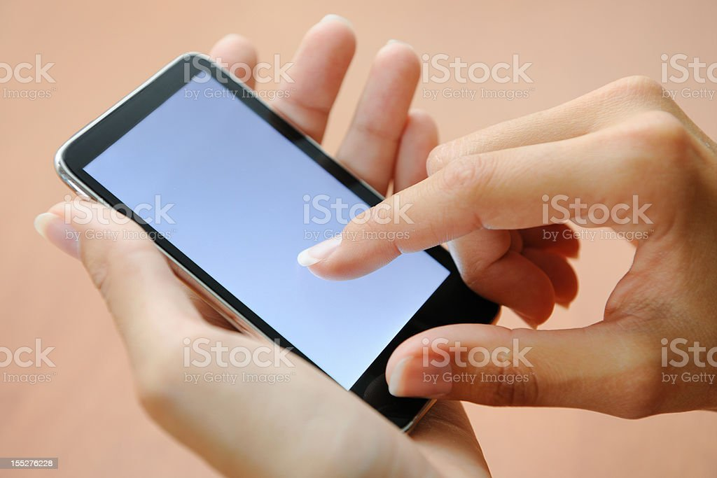 Finger pointing on a Smart Phone (XXXL) royalty-free stock photo