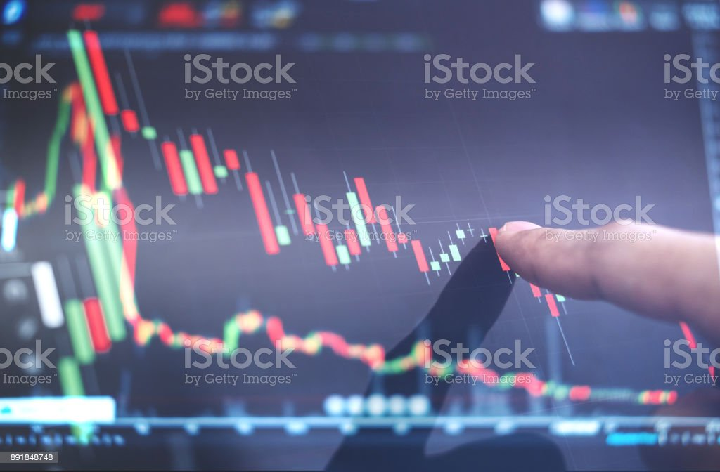 Finger pointing on stock exchange market chart stock photo