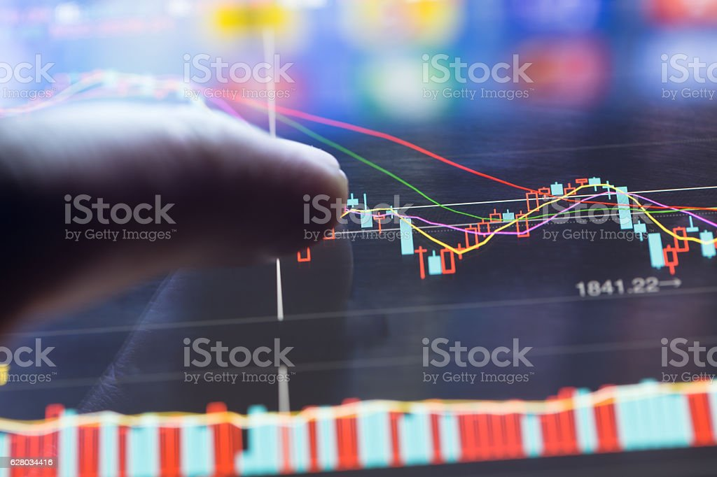 finger  pointing to the market data stock photo