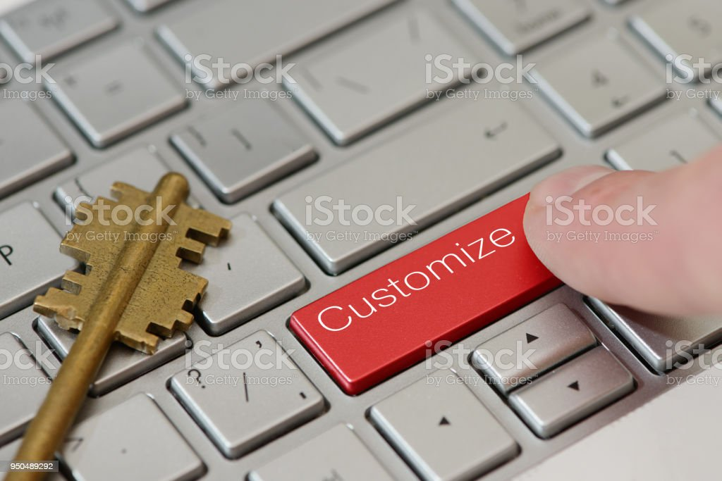 A finger press a button with text Customize on a keyboard stock photo