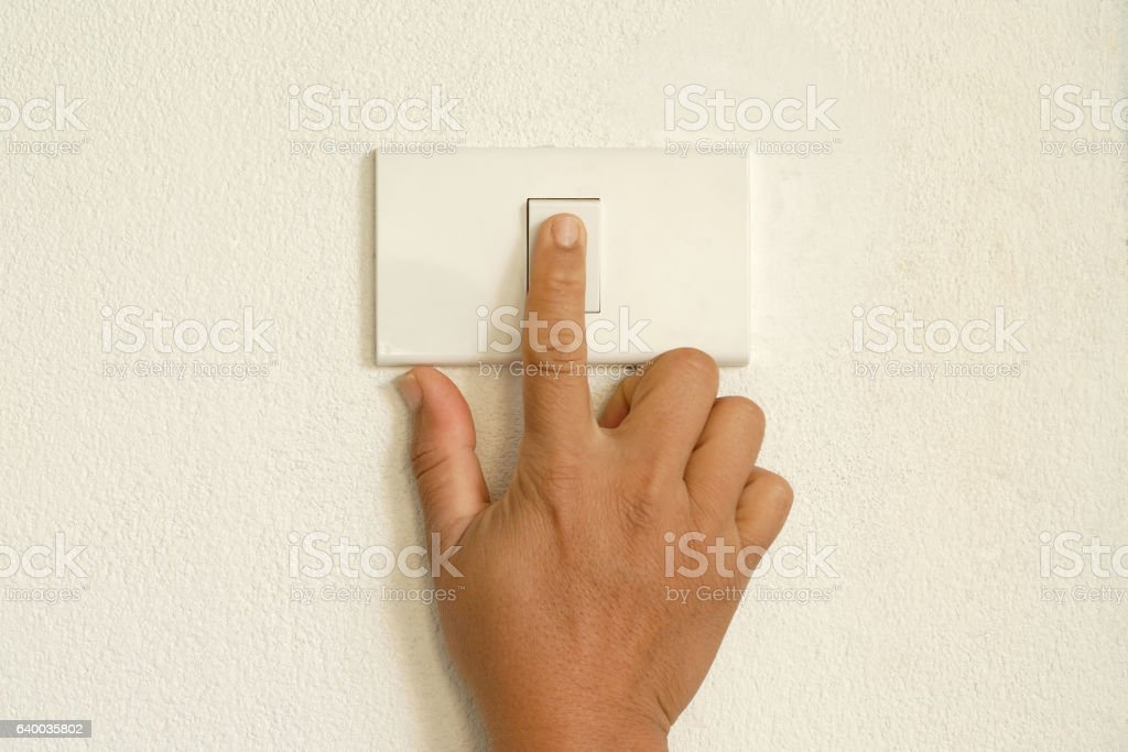 finger press lighting switch stock photo