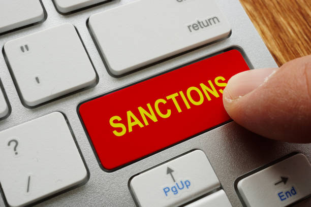 Finger presses the button sanctions. Finger presses the button sanctions. sanctions stock pictures, royalty-free photos & images