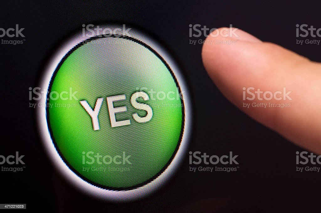 Finger Pressing A Green Yes Button On Touchscreen Stock