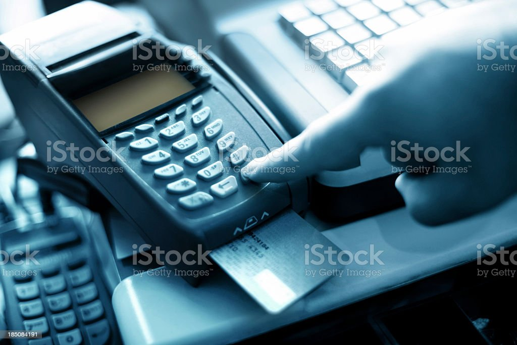 Finger pressing button on bank card reader royalty-free stock photo