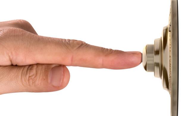 finger pressing doorbell - call center стоковые фото и изображения