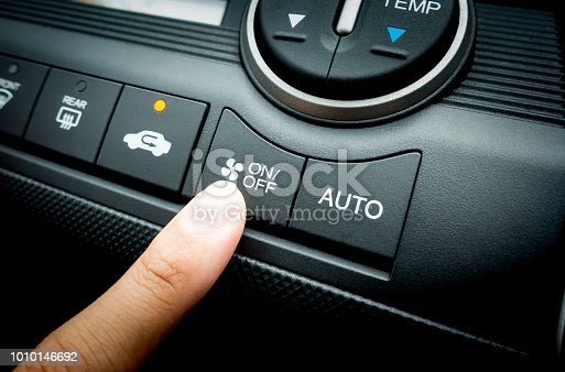 istock Finger pressing on Power switch of a Car air conditioning system 1010146692
