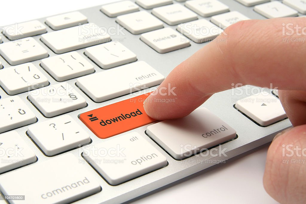 Finger pressing orange download button on a white keyboard  royalty-free stock photo