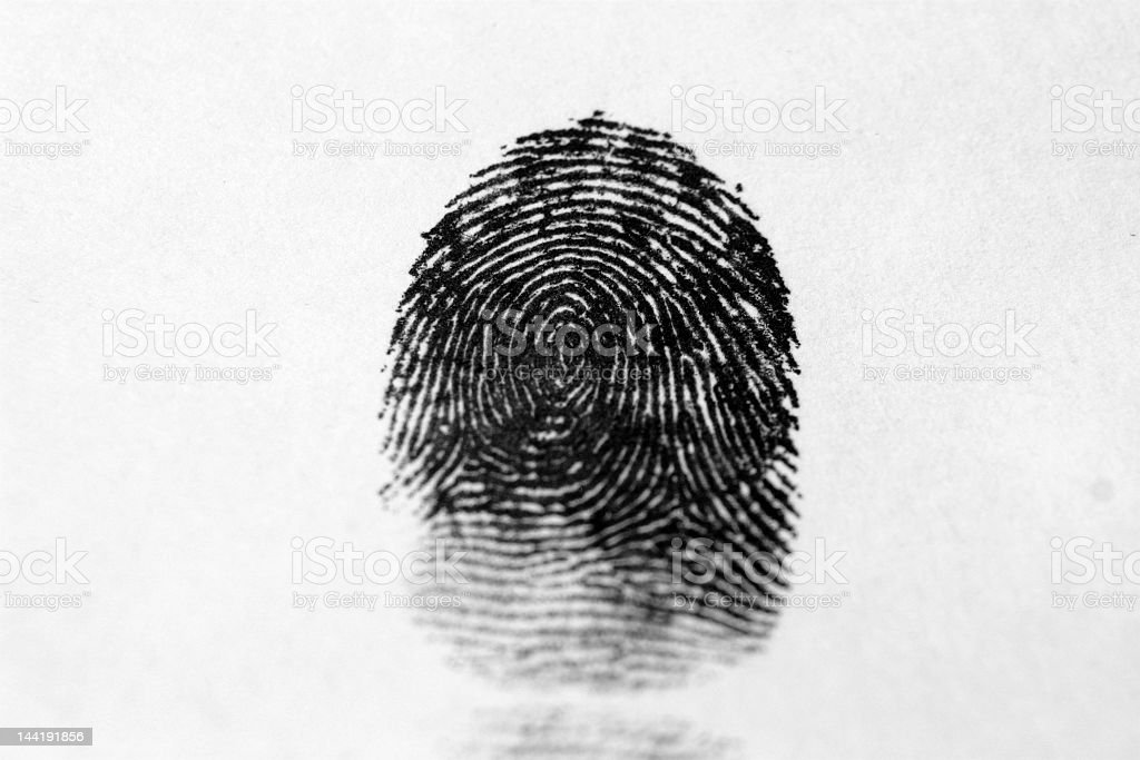 A finger print in black on a white background stock photo