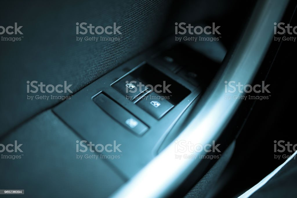 Finger push lock button of car doors royalty-free stock photo