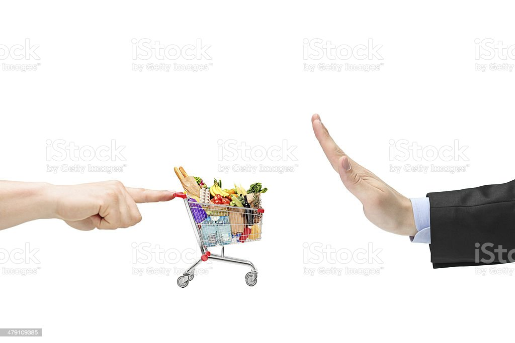 Finger pushing a shopping cart and male hand gesturing stop stock photo