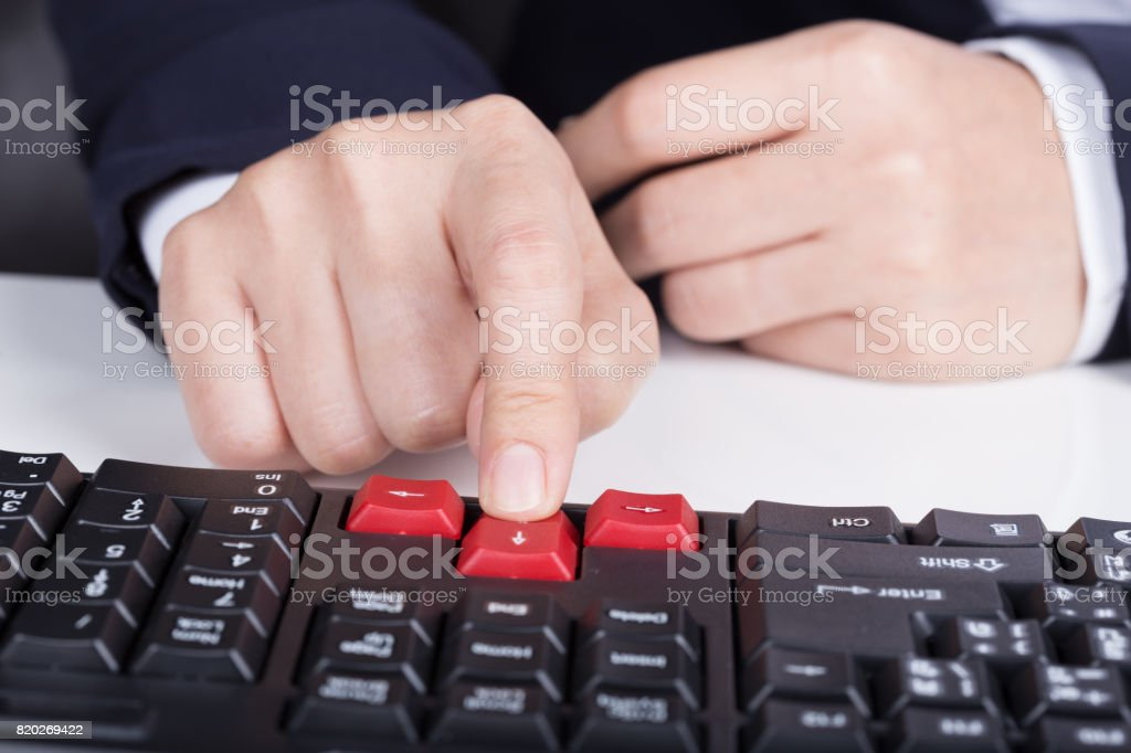 Finger Pushing Arrow Button On Keyboard Computer Stock Photo More