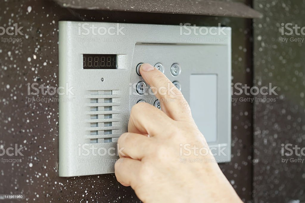 finger pushing button of  intercom stock photo