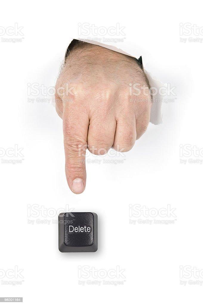 Finger pushing delete key. royalty-free stock photo