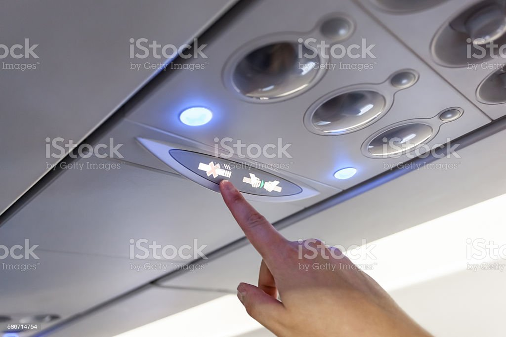 Finger show on No Smoking Sign Inside  airplane stock photo