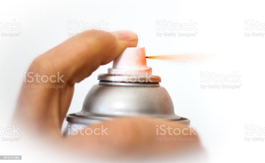 Finger Spraying Aerosol Red Paint, Close-Up, White Background photo libre de droits