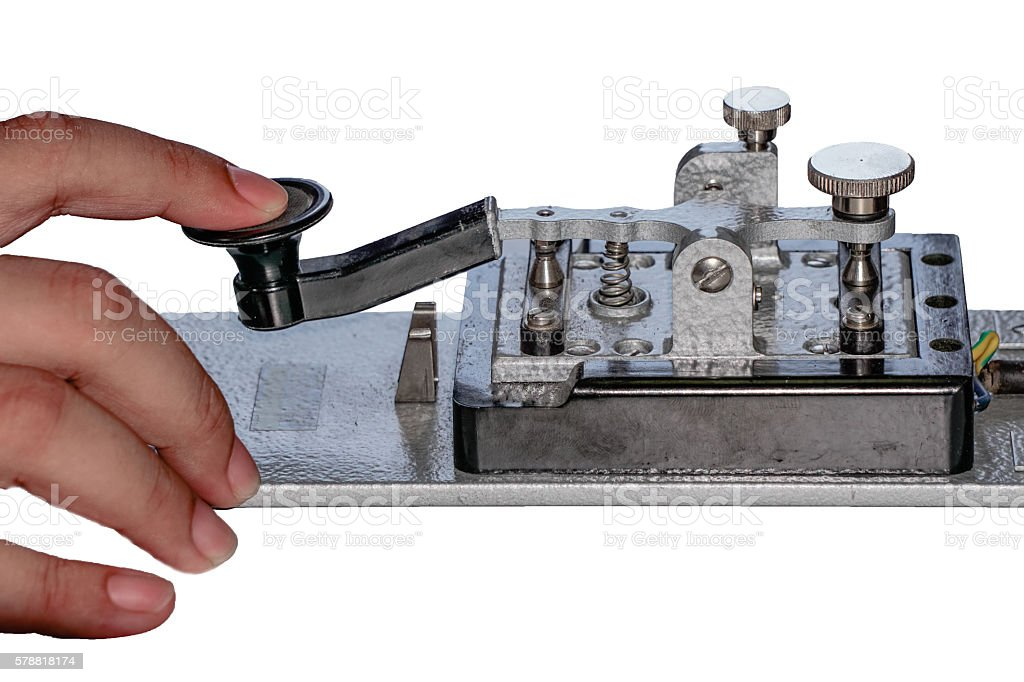 finger tapping on morse telegraph key stock photo