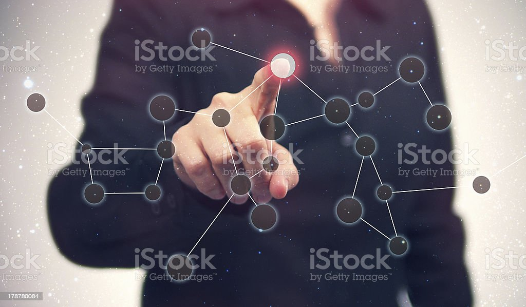 Finger Touches Button Interface in a Constellation Network Pattern royalty-free stock photo