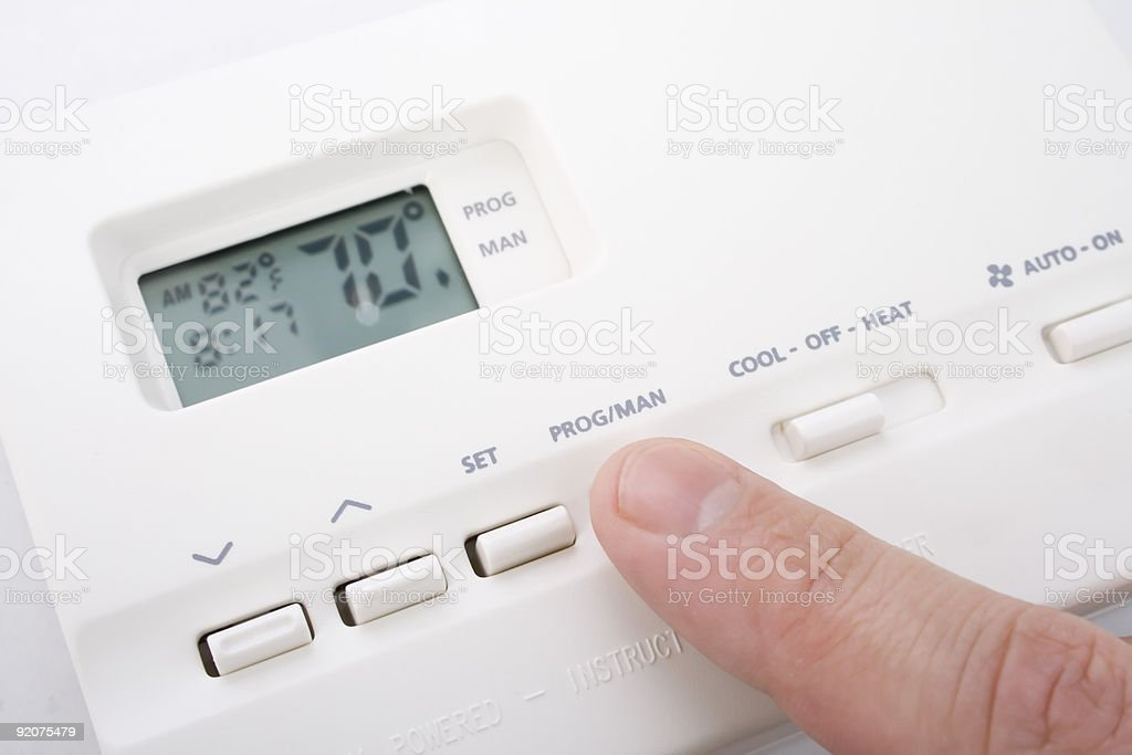 Finger touching an air conditioner climate control device stock photo