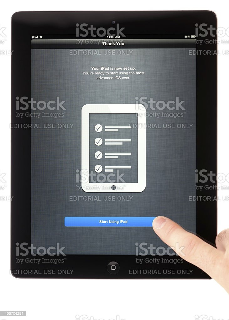 Finger Touching Finish Button, Initial Configuration of New iPad 3 stock photo