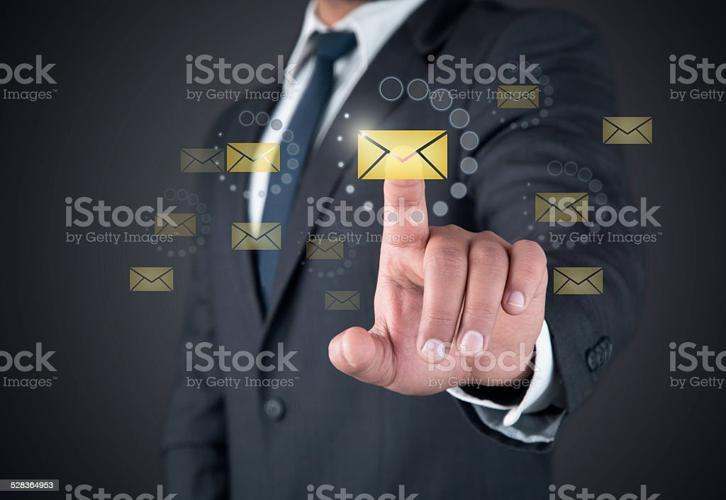 Finger touching loading mail button on a touch screen stock photo