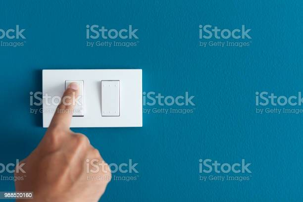 Finger turning on lighting switch on rough on blue dark wall picture id988520160?b=1&k=6&m=988520160&s=612x612&h=duw1zmxafk5sn2ehsn2u2hqwmickzxtvpqk iw1aagm=