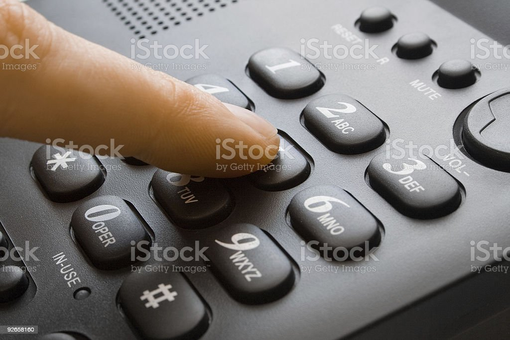 finger with black keypad stock photo
