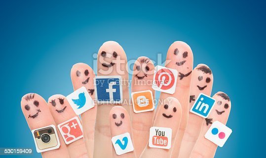 istock Finger with popular social media logos printed on paper. 530159409