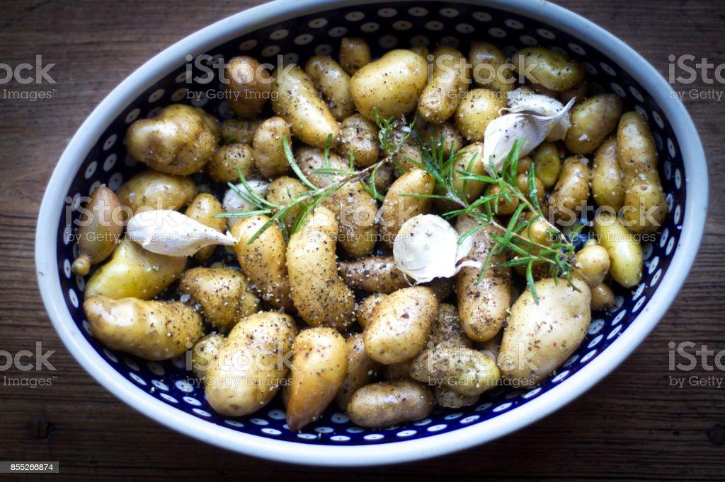 Fingerling Potatoes, Garlic, Rosemary in Baking Dish stock photo