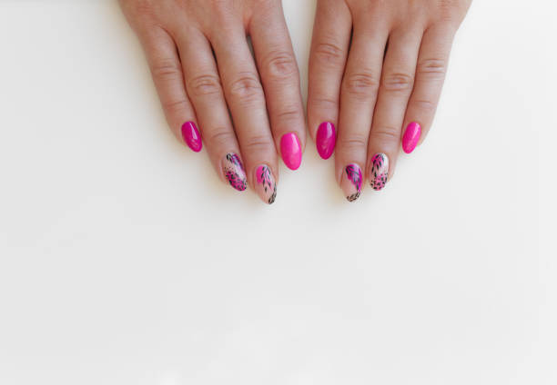 Fingernails gel with colorful pattern. Woman hands on white background stock photo