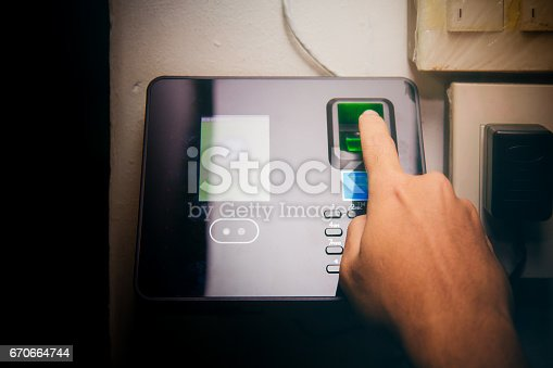 istock fingerprint and access control in a office building 670664744