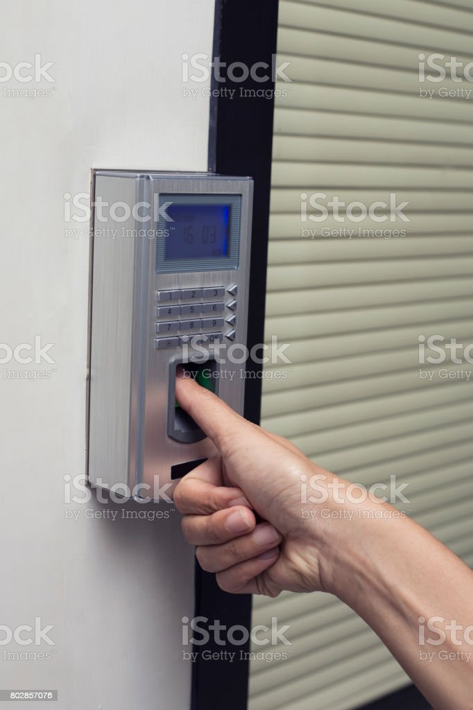 fingerprint and access control in a office building stock photo