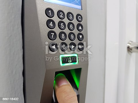 istock fingerprint and access control in a office building 886118402