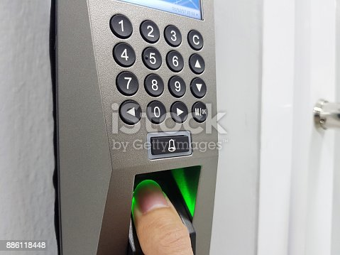 istock fingerprint and access control in a office building 886118448