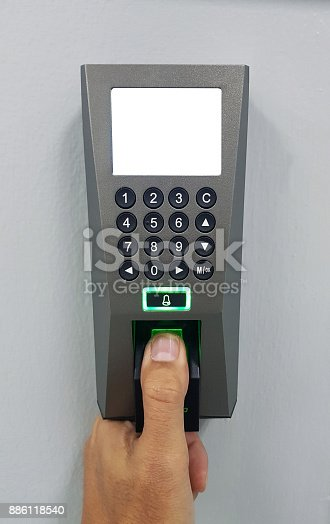 istock fingerprint and access control in a office building 886118540