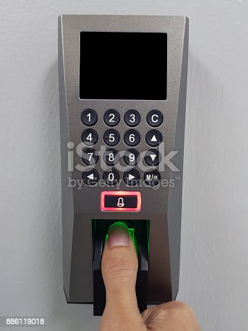 istock fingerprint and access control in a office building 886119018