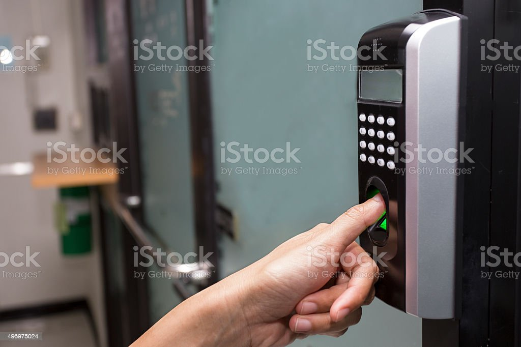 fingerprint and password lock control in an office building stock photo