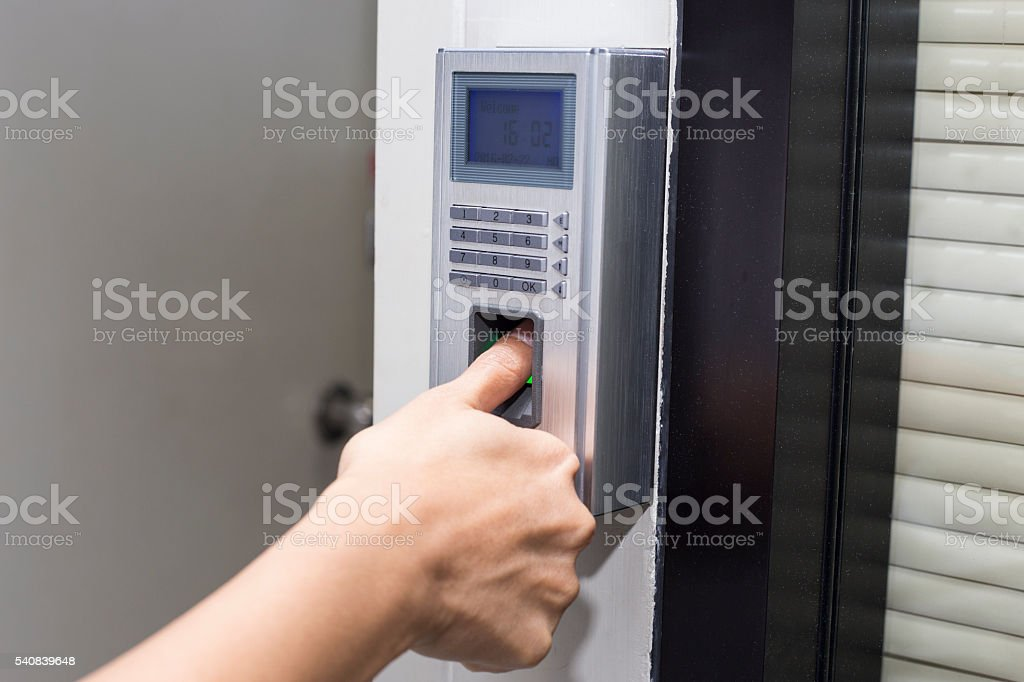 fingerprint and password lock in a office building stock photo
