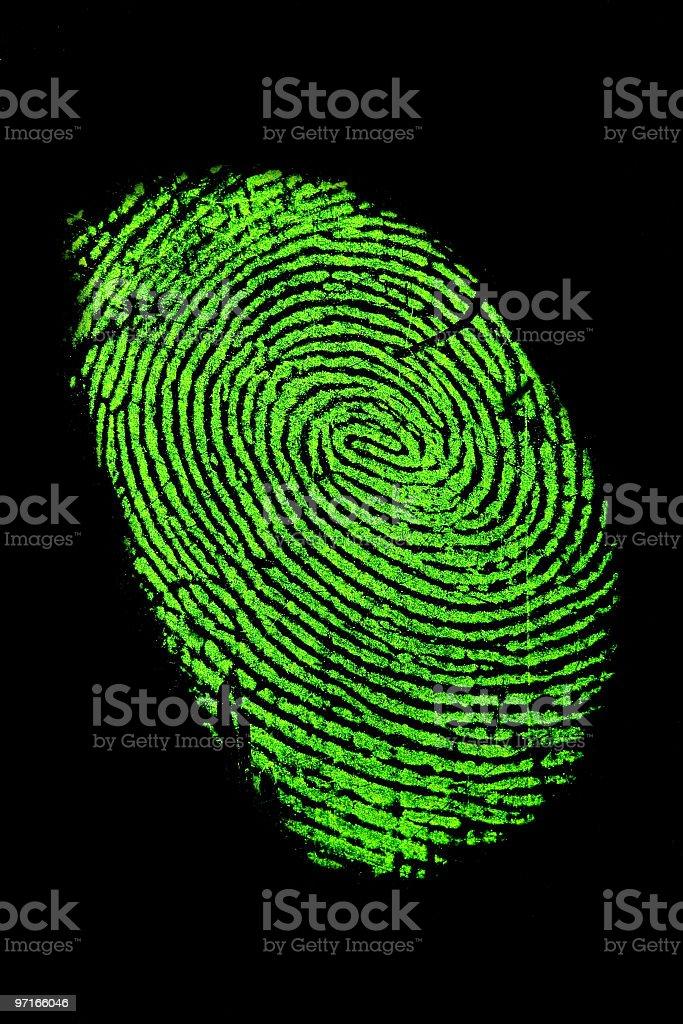 Fingerprint in green neon for fluorescence stock photo