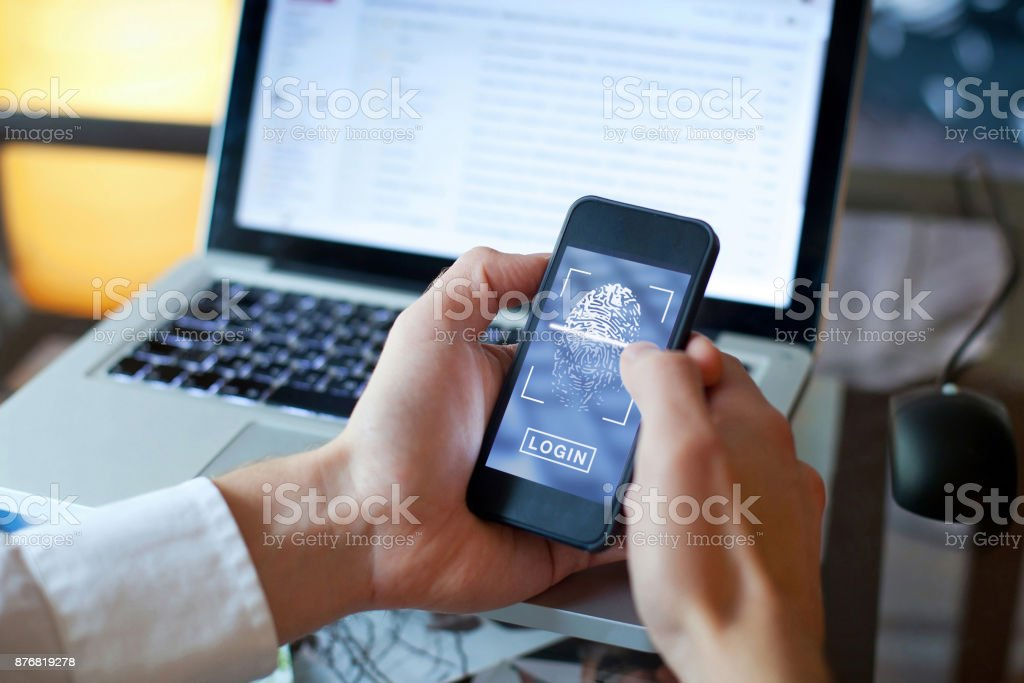 fingerprint login access on smartphone, data security stock photo