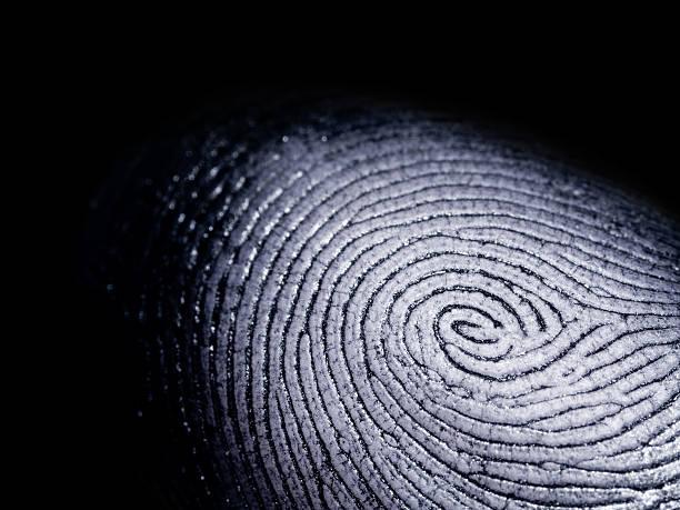 fingerprint on black - fingerprint stock photos and pictures