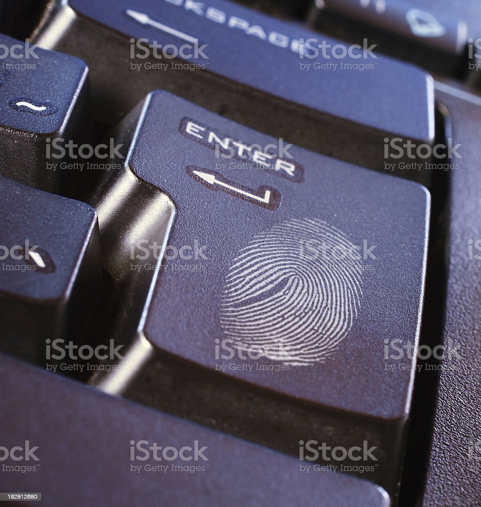Fingerprint on keyboard button royalty-free stock photo